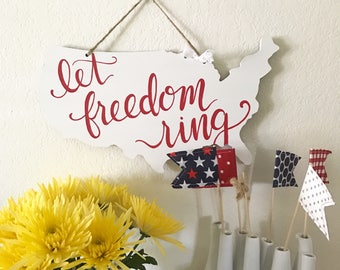 America cut-out sign: Let Freedom Ring