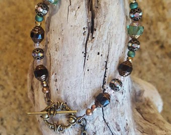 7.5 inch bracelet in bronze with green & black Czech Glass beads and two dangles