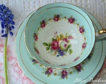Victoria, England: Blue tea cup & saucer with charming pink flowers