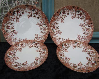 Two pairs of serving and side plates.