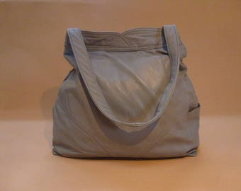 light gray recycled leather bag