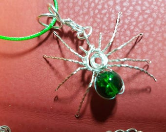 Spider pendant on corded necklace.