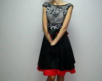 A dress in the style of a NewLook ( Red and Black)