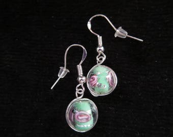 Earrings in silver with glass beads
