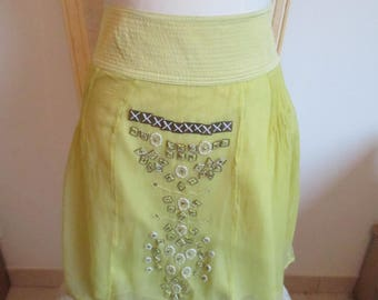 fancy woman mustard colored skirt