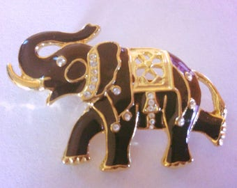 Vintage brooch, black enamel lucky elephant with clear rhinestones and outline in gold  brooch