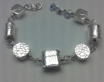 Sterling silver hand fabricated bead bracelet.
