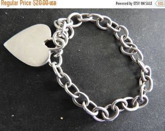 ON SALE stunning vintage sterling silver charm bracelet with heart tag