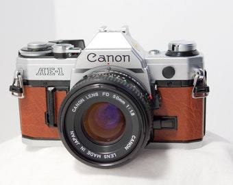 Canon AE-1 35mm camera with new custom leather cover & super fast Canon FD 50 mm 1:1.8