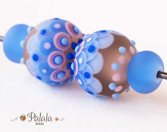 Set of blue and pink matted lampwork beads