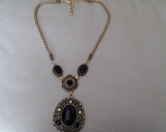 Gold and black evening necklace