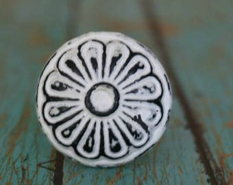 Round Metal Cabinet Knob With Floral Pattern in Distressed Finish