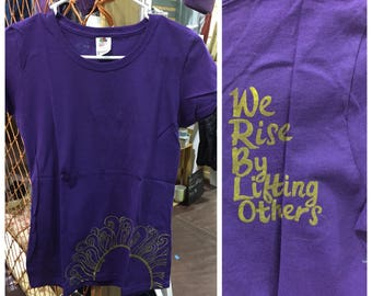 "WOMEN'S  ""We Rise By Lifting Others"""