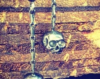 Skull and chain earrings