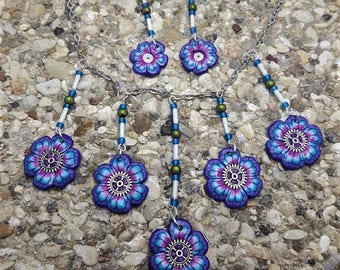 Blue and pink flowers in polymer clay beads and steampunk finery