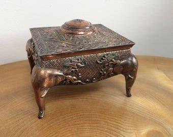 Vintage Hollywood Regency Silver Plate on Copper Ornate Trinket Box - Elephant head legs, blue velvet lining