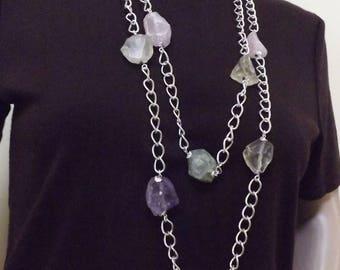 Long multiple gemstone necklace.