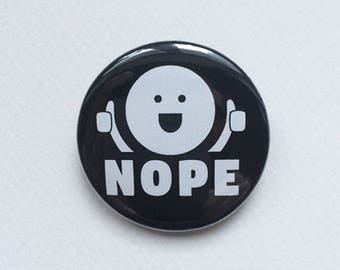 Nope Badge