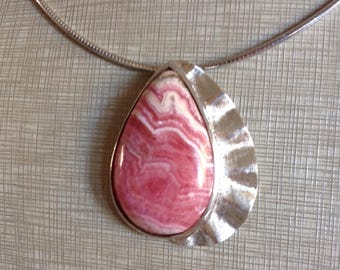 Sterling Silver and rhodochrosite.