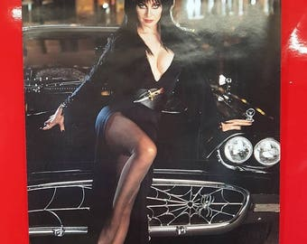 SALE 1980's Elvira Movie Poster Antique Elvira Mistress Of The Dark Movie Advertisement 80 90s Nerd Pop Culture Art Deco Collectible Movie P