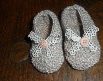with a lace bow baby shoes