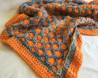 Small/medium chunky handknitted orange and blue blanket