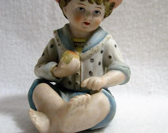 Andrea Sadek - Boy Figurine With Feather Cap and Apple