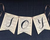 Christmas Banner, 'Joy', on sheet music with colored ribbon, mantel decoration, fireplace decoration, antique coloring