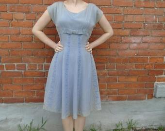 Striking vintage 1950s dress with soutache trim