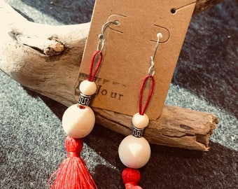 Red tassel and white wood dangle earrings.