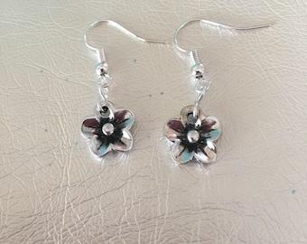Silver earrings.  Silver dangle earrings.  Silver flower drop earrings.  Silver ear wires.