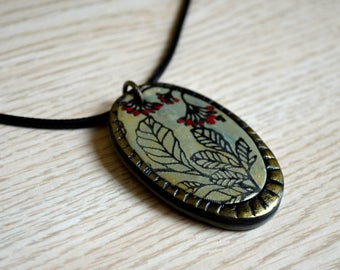 Hand made polymer clay floral pendant