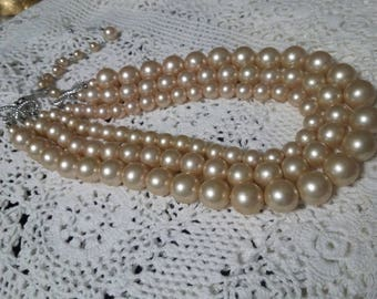 Three strands of faux pearls vintage necklace