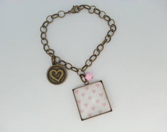 Bracelet and glass cabochon 25 mm white and pink heart.