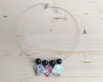 Gift paper and black pearls necklace