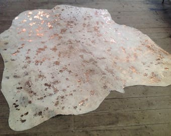 large cowhide rug in ivory with metallic gold made with 100 premium hairon