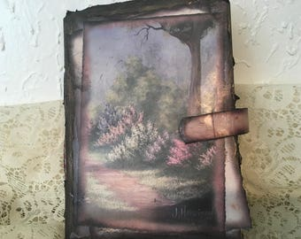Beautiful picture journal. Lots of space to write on high quality papers. This one is vintage and distressed . Magnetic closure. Hi quality.