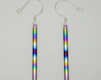 Anodized rainbow colours titanium and silver 925 swinging earrings. Titanium jewelry.