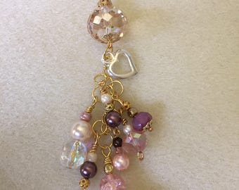 Elegant purse charm in gold tones, peach and pearls