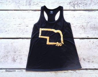 Black tank top with gold Nebraska