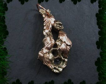 Copper leaves on bronze pendant