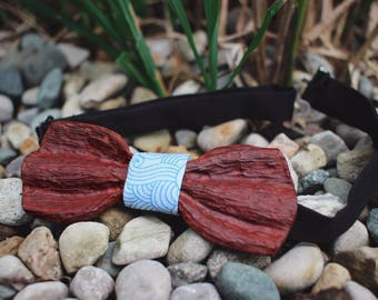 Distressed red wood bow tie. With white and blue center piece