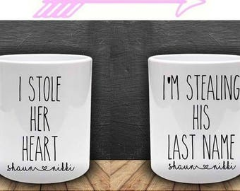 I stole her heart. I'm stealing his last name. Mug pair, ideal valentines gift. Engagement present. Future husband and wife.