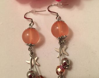50/100 discount! Coral colored steel earrings