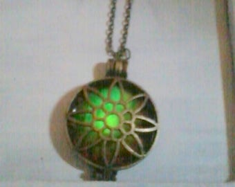 round Locket with fluorescent filigree flower pendant