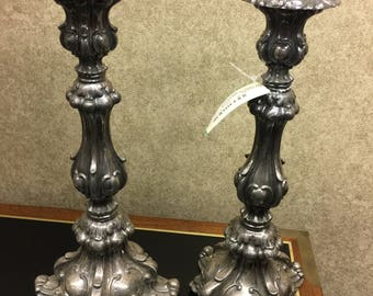Pair of ornate antique silver plate candlesticks