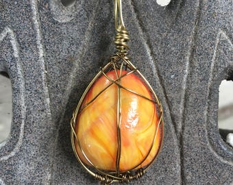 Red and yellow stone pendant