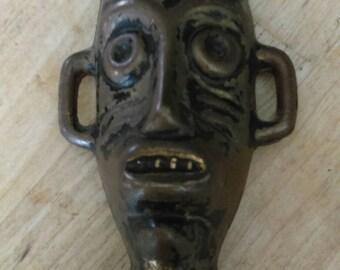 Vintage metal African mask corkscrew bottle opener