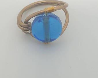 Blue glass ad copper wire ring