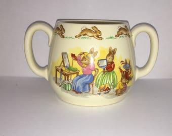 Royal Doulton Bunnykins Two Handled Mug - 1954 - Hat Shop Pattern